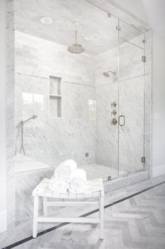 Elaborate shower with glass walls and grey and white tile   Erin Hedrick Design