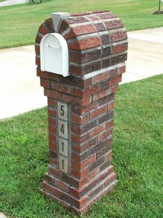 elegant and slim brick mailbox design idea on green grassy meadow and white accent with bold arched style Mailbox Garden, Mailbox Landscaping, Outdoor Landscaping, Outdoor Decor, Landscaping Ideas, Outdoor Ideas, Outdoor Gardens, Stone Mailbox, Gardens