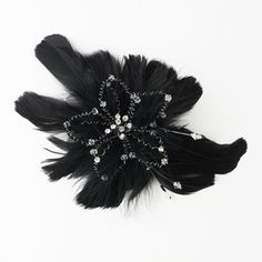 The Floral Hair Fascinator with Crystals Clip and Additional Brooch Pin Component is an enchanting feather fascinator featuring rhinestones and Swarovski crystals nestled into a bed of beautiful feathers. http://www.elegantbridalhairaccessories.com/shop/bridal-hair-flower-accessories/floral-fascinator-brooch-pin-hair-clip/