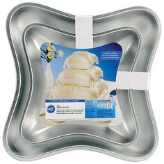 Create a romantic tiered wedding cake in a classic ring pillow shape with this cake pan. Use each pan twice to achieve the full pillow effect. Materials: Aluminum Stack the tiers for a dramatic presen
