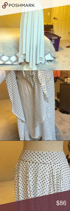 Free People Blk/Wht Skirt on the back there is a stretchy part so it is easy to get on! it's super cute, great condition. make me offers! Free People Skirts