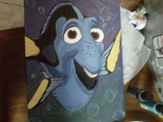 "Dory from the movie ""Finding Nemo"".... I painted this on a cheap board found at Hobby Lobby with acrylic paints.."