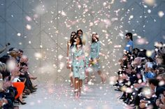 UNITED KINGDOM, London : Modeld present creations by Burberry Prorsum during the 2014 Spring/Summer London Fashion Week in London on September 16, 2013. AFP PHOTO / BEN STANSALL