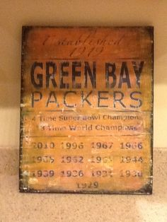 Decoupage and distressed wood sign. Green Bay packers