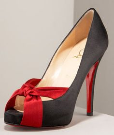 Wowza!  Christian Louboutin. Black peep toe pumps with a red fabric criss cross at the toe
