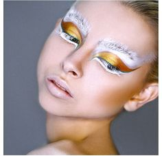 Frosty eye makeup ....hmm, the gold is an interesting contrast. Makes it look more bird like than frosty in my opinion but still cool.