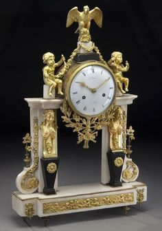 French Empire style clock surmounted by eagle : Lot 25
