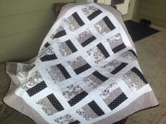 A quilt made with taupe/black and white i loved the  colour. just right for a special sister .a once day quilt.