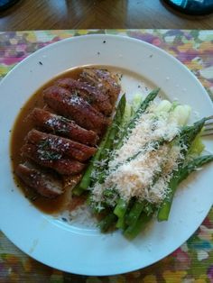 Pan friend duck breast. Apricot ginger sauce, Parmesan topped asparagus