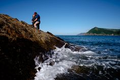 Engagement photoshoot in North Devon looking along the Exmoor coastline towards Lynmouth from Combe Martin