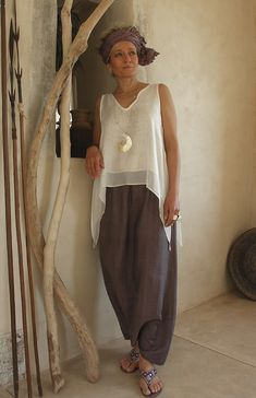 Top made of white silk veil worn over a purple shantung harem pants