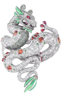 Harumi for Chopard's Dragon bracelet features rubies, diamonds, emerald & turquoise; fuses the major cultural symbols of the Chinese dragon with the Aztec plumed serpent.