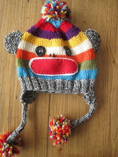 Knitted sock monkey hat ... free pattern here: http://jennicanknit.blogspot.com/2011/12/sock-monkey-hat.html