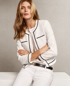 Clean lines: A white jacket with navy piping pulls everything together. Dress up this look with our essential wedge sandal or play to its sporty vibe with a pair of sneakers. #anntaylor #navyandwhite