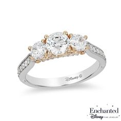 A perfect fit, this sparkling diamond engagement ring from the Enchanted Disney Jewelry Collection inspired by Cinderella is a glamorous choice. Crafted in 14K two-toned gold this gleaming design features a 5/8 ct. round diamond flanked by two 1/3 ct. diamonds - set in rose gold. The pinched shank dazzles with diamonds in white gold, while small crown insets lower down on the band and a ribbon of diamonds under the center stones complete the magical look. Captivating with 1-1/2...