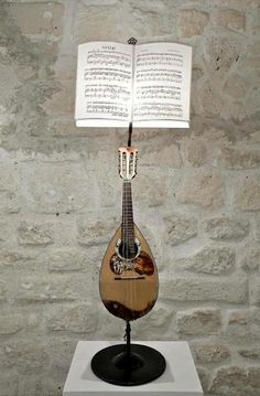 Lamps with stringed musical instruments
