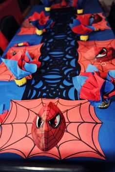 via The Party Wall: Spiderman Birthday Party ideas - placemats and masks