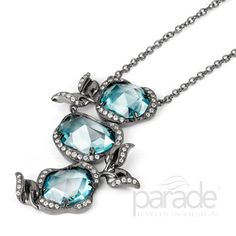 Parade's signature leaf design envelopes pools of vivid blue zircons in a free-form 18K white gold necklace finished with black rhodium. Parade Designs - Parade In Color  - Style: N2812A-FS