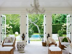 """Indoor/Outdoor living is essential in the Hamptons. Large windows and french doors help bring the outdoors inside. """"Aerin Lauder's Book, Beauty at Home, Showcases Her Passion For Interior Design : Architectural Digest"""" Indoor Outdoor Living, Outdoor Rooms, Outdoor Furniture Sets, Cane Furniture, Outdoor Kitchens, Wicker Furniture, Die Hamptons, Jardin Decor, Interior Exterior"""