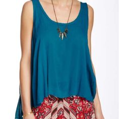 """🎉Host Pick 6/22🎉 Free People Swing Cami 🎉Back To Basics Host Pick 🎉Flattering fit, scoop neck, sleeveless & made from a gauzy fabric. High-low hem. Color is called Peacock (blue). Size small. Approximately 23"""" shortest point & 27"""" longest point. White version also available in closet. Ask if you have questions. Thank you @molinda25 💖💖 Summer. Camisole. Tank top. Gypsy. Festival. Boho. Sexy. Free People Tops"""