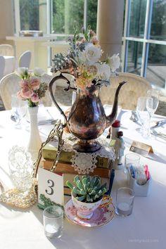 Vintage table scape one of a kind decor from Rent My Dust vintage rentals Romantic Secret Garden Wedding, Silver teapot, pearls, perfume bottles, lace, teacups tea party wedding, rentmydust.com, succulent