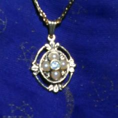 """""""Sale"""" 1980s Avon Necklace Classic Avon piece. Gold tone metal, faux pearls and clear stone. Very pretty and Danty. 18"""" long and charm hangs about 1"""" . Avon Jewelry Necklaces"""