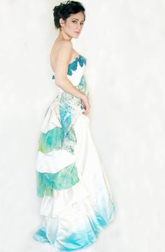 Unique upcycled corset back wedding gown with blue hand-dyed silk accents. $1,195.00, via Etsy.