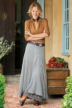 Pretty embroidered scalloped lace-attached to the full lining-peeks out at the hem of this soft and swingy sweater-knit panel skirt, designed with a comfy pull-on elastic waistband. Comes with a detachable leather-look tie belt