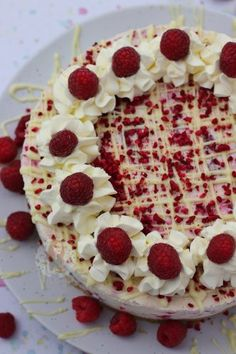 A No-Bake White Chocolate and Fresh Raspberry Cheesecake with a Buttery Biscuit Base, White Chocolate & Raspberry Cheesecake Filling, with Fresh Cream, White Chocolate Drizzle...