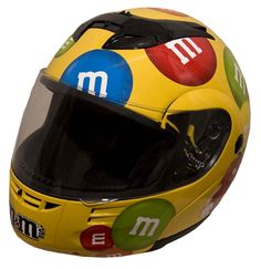 Ride in style while keeping yourself safe with this RZ80 Full Face Yellow M&M DOT Motorcycle Helmet. Description from overstock.com. I searched for this on bing.com/images