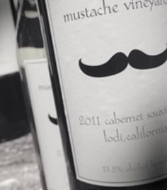Mustache Vineyards WINES - It's all about the Mustache and a great glass of wine. Who doesn't love mustaches?  This year we had a great harvest of Mustaches and you can enjoy a wonderful Chardonnay, Pinot Noir, Merlot and a Cabernet Sauvignon. Old Vine Zinfandel coming soon.