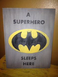 A Superhero Sleeps Here Batman Sign Primitive Vintage. $23.00, via Etsy.