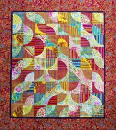 Drunkard's path quilt with stripes, plaids and flowers by Ina Klugt, featured at the Dutch Modern Quilt Guild.