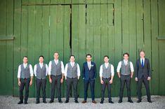 groomsmen in vests, groom in a ballin' suit....best man in a nice looking but slightly less ballin' suit