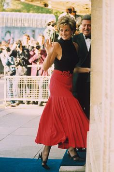 1995 - Diana wore an ankle-length red pleated skirt with a sleeveless black poloneck as she greeted well-wishers before entering the Royal Albert Hall.