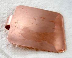 Vinegar and Salt Patina on Copper.   Be sure to clean off any protective coating from the metal before beginning.