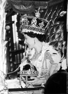 Queen Elizabeth II wearing the State Crown and carrying the State orb in a Royal carriage after her Coronation ceremony. (Photo by Picture Post/Hulton Archive/Getty Images). 2nd June 1953