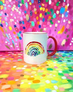 Rainbow Happy mug by Sarah Coey Art. Cute kitchen ware, rainbow gifts, happy gifts