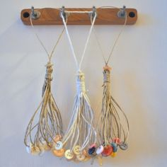 Button Tassels...great tutorial...could use for gift embellishments, hang from a tree...make a garland..just fun