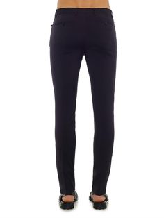 Lanvin Slim-leg wool trousers Lanvin's navy wool trousers are a fresh alternative to traditional black styles. They are cut to a sharp, slim silhouette and have unfinished hems to allow for a precise finish.