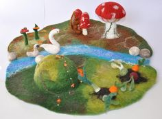Waldorf and nature inspired landscape, play mat, play-mat with 3D elements: stream big and small mushroom veggie patches flowers pebbles Ideal for your season table and for you/for your children to play stories on it. The dimensions of this medium size landscape: diameter of 39 cm = 15 inches Height of the cave, mushroom: about 9 cm / 3,5 You can watch step motion video at my Instagram profile or Youtube channel: https://www.instagram.com/nemezinda/ https...