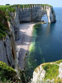 Étretat, France - the 80-mile stretch of sheer cliffs between Dieppe and Etretat, in upper Normandy, is mirrored by those of the English coast of Dover, pointing to their shared geological origin.