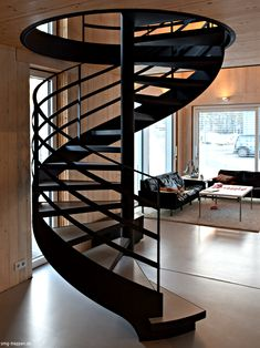The spiral staircase SPT 2300 with tub steps and outer cheek made of steel is the perfect contrast in a wooden house in the Brandenburg Elstal. Spiral staircase SPT 2300 - SMG stairs Lisa Schmidt frauschmidt Dachterrasse/ Etage aufstocken The spira Spiral Stairs Design, Staircase Design, Stairway Decorating, Escalier Design, Building Stairs, Stair Railing, Railing Ideas, Stairways, Architecture Design