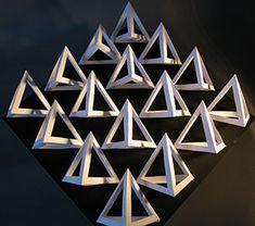 "Three Dimensional Design Syllabus Bristol board high relief, modular grid of curvilinear, asymmetrical forms arranged in a close packed 16 - 25-unit grid on 16"" X 16"" mat board."