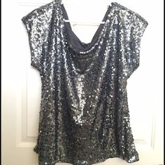 NWT Fully Covered Sequin Party Top! Gray/Gray! BRAND NEW / NEVER WORN!! NWT Fully Covered Sequin Party Top! Gray/Gray! The all-over sequins really glam up a pair of black leggings and boots/booties, or wear it under a jacket! Express label is slightly coming off. Express Tops