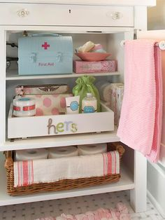 organized bathroom cabinet. love the lunch box turned first aid kit. ~via @Better Homes and Gardens