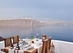 Lycabettus, Santorini-Greece is no stranger to gorgeous settings, but the cliff-side Lycabettus at Andronis Luxury Suites may top the charts. Grab a private table on the dramatic rocky outcrop that juts out over the turquoise Aegean Sea. The Mediterranean menu complements the landscape, with Greek dishes like fresh veggie salad with white truffle vinaigrette and flowers in volcanic soil, plus a rack of lamb with eggplant mousse and lamb-braised croquettes.
