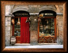 Bicycle Parked Outside Historic Food Store, Siena, Tuscany, Italy Stretched Canvas Print by John Elk III at Art.com
