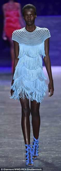 Models glided down the runway in tiered fringe dresses in shocking yellow and baby blue...