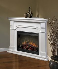 I like the idea of a corner electric fireplace, but with a wood finish. Not white. Great place to have story time with the kids or book club meetings with adults.